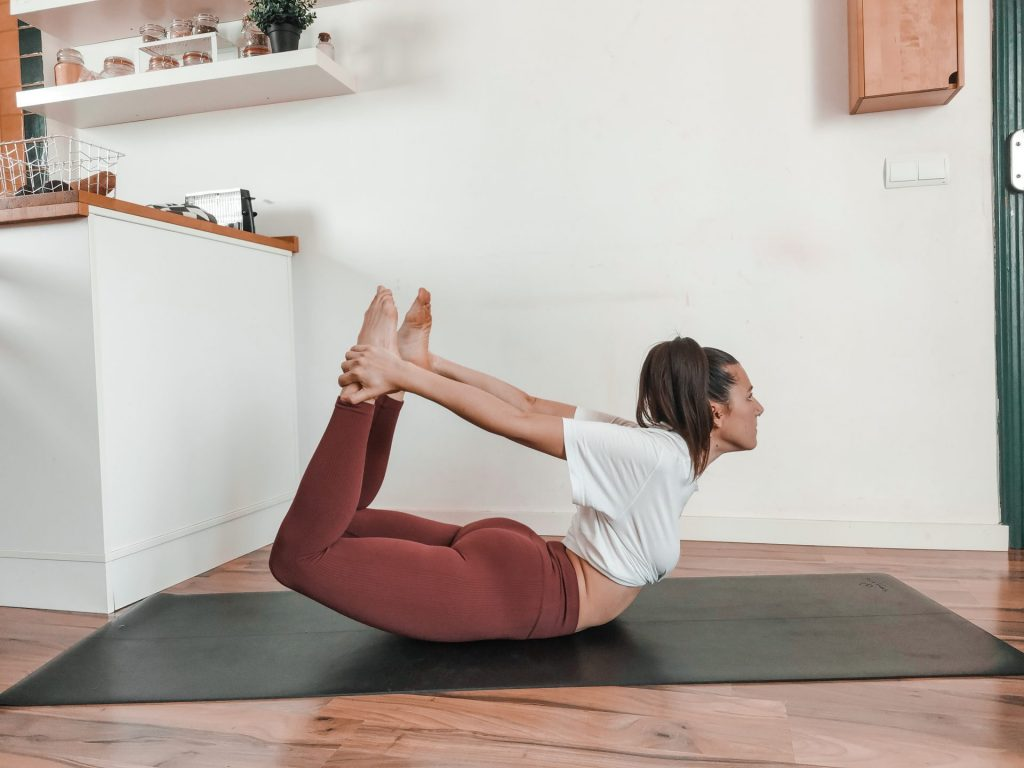 Dhanurasana arch posture for back flexibility
